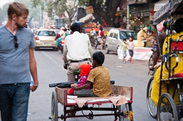 Hitching a ride on the streets of Delhi. Randy does a double take.