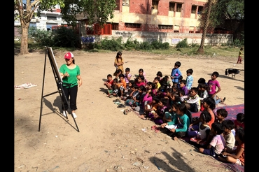One of our producers, Katrina, helping educate kids on English. Everyone got into the spirit.